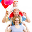 Kid with parents celebrating birthday and blowing candles on ca — Stock Photo #21090181