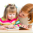 Happy mother and child reading a book together — Stock Photo #21090197