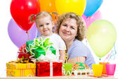 Little girl and mother celebrate birthday holiday — Stock Photo