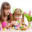 Mother and daughter kid painting easter eggs isolated — Zdjęcie stockowe #21175385