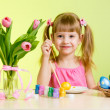Child painting Easter eggs — Stock Photo