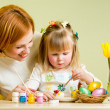 Stock Photo: Mother and daughter kid painting easter eggs