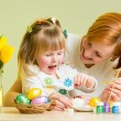 Stock Photo: Mother and kid girl play and prepare to easter