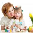 mother and kid girl paint easter eggs isolated on white — Stock Photo
