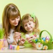 Mother and daughter kid painting easter eggs — Stock Photo #21175451