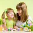 Mother with child girl play and paint easter eggs — Photo