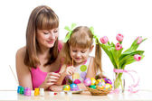 Mother and daughter kid painting easter eggs isolated — 图库照片