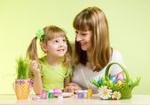 Mother with child girl play and paint easter eggs — Stock Photo