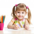 Cute girl drawing with colourful pencils — Stock Photo #21276009