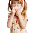 Child girl wiping or cleaning nose with tissue isolated on white — Stock Photo #21276025