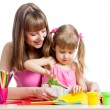 Royalty-Free Stock Photo: Mother teaches preschooler kid to do craft items. DIY concept.