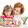 Mother and her child girl pencil together — Stockfoto