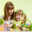 Foto Stock: mother and child girl prepare to easter holiday
