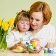 mother and child kid paint easter eggs  — Stock Photo