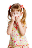 Child girl wiping or cleaning nose with tissue isolated on white — Stok fotoğraf