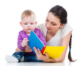 Mother reading a book her baby girl — Stock Photo