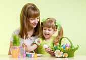 mother and child girl prepare to easter holiday — Stok fotoğraf