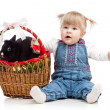 Funny baby girl with Easter bunny in basket — ストック写真