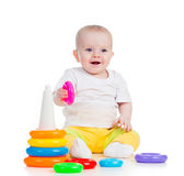 Happy baby girl playing with colorful toy isolated on white — Stock Photo
