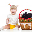 Funny baby girl with Easter bunny in basket — Stock Photo #21699951