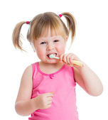 Baby cleaning teeth and smiling, isolated on white background — Fotografia Stock