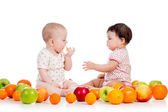 Two children kids eating together healthy food fruits isolated o — Stock Photo