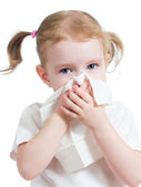 Kid cleaning nose with tissue isolated on white — Stockfoto