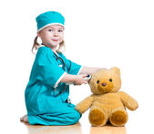 Doctor girl playing and measuring temperature toy isolated on w — Stock Photo