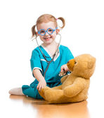 Adorable child with clothes of doctor over white — Stock Photo