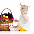 Funny baby girl with Easter bunny in basket — Stock Photo #21851441