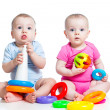 Kids boy and girl playing toys together — Stock Photo #21851421