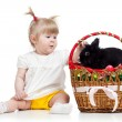 Funny baby girl with Easter bunny in basket — Stock Photo