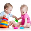 Kids boy and girl playing toys together — Stock Photo #22152225