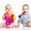 Funny children girl and boy playing with musical toy. Isolated o — Stock Photo