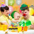 Family celebrating first birthday of baby — Stok fotoğraf