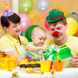 Family celebrating first birthday of baby — Stockfoto