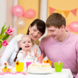 Family celebrating first birthday of baby daughter — Stockfoto