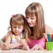 Mother and her child girl pencil together — Stock Photo #23382598