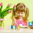 Cute kid girl painting Easter eggs — Stock Photo #23382626