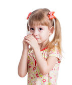 Kid wiping or cleaning nose with tissue isolated on white — Stock Photo