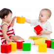 Two babies or kids playing together with color toys — 图库照片