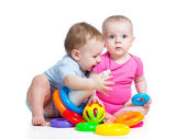 Kids boy and girl playing toys together — Stock Photo