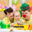 Family celebrating first baby's birthday — Stock Photo