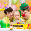 Family celebrating first baby's birthday - Stock Photo