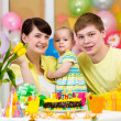 Family celebrating first birthday of baby daughter — ストック写真