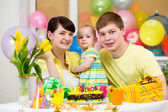 Family celebrating first birthday of baby daughter — Stock Photo
