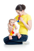 Mother and baby girl having fun with musical toys. Isolated on w — Stock Photo
