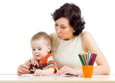 Baby boy and mother drawing with colorful pencils — Zdjęcie stockowe