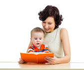 Happy mother reading a book child — Stock Photo