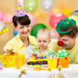 Family celebrating first birthday of baby girl — ストック写真